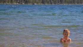 Cute Shirtless Boy Swimming In Lake