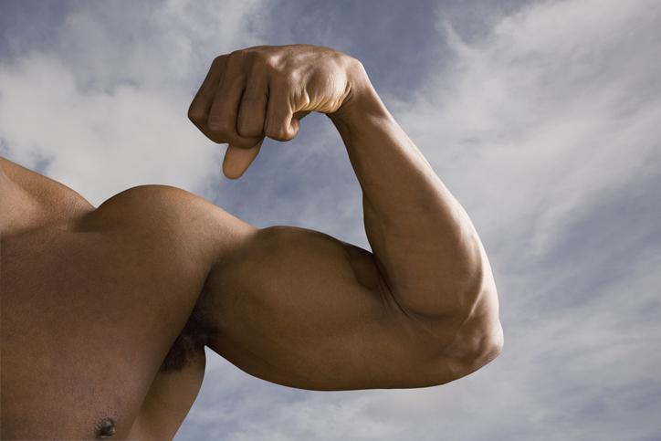 Close up of man's flexed biceps