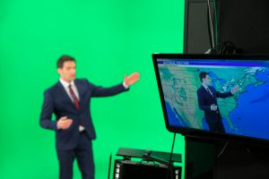 Weather forecaster on green background