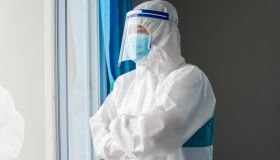 Doctor wearing protective suit to fight coronavirus pandemic covid-2019.