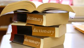 Stack of dictionaries on a desk