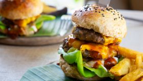 Two homemade beef burgers with mushrooms,